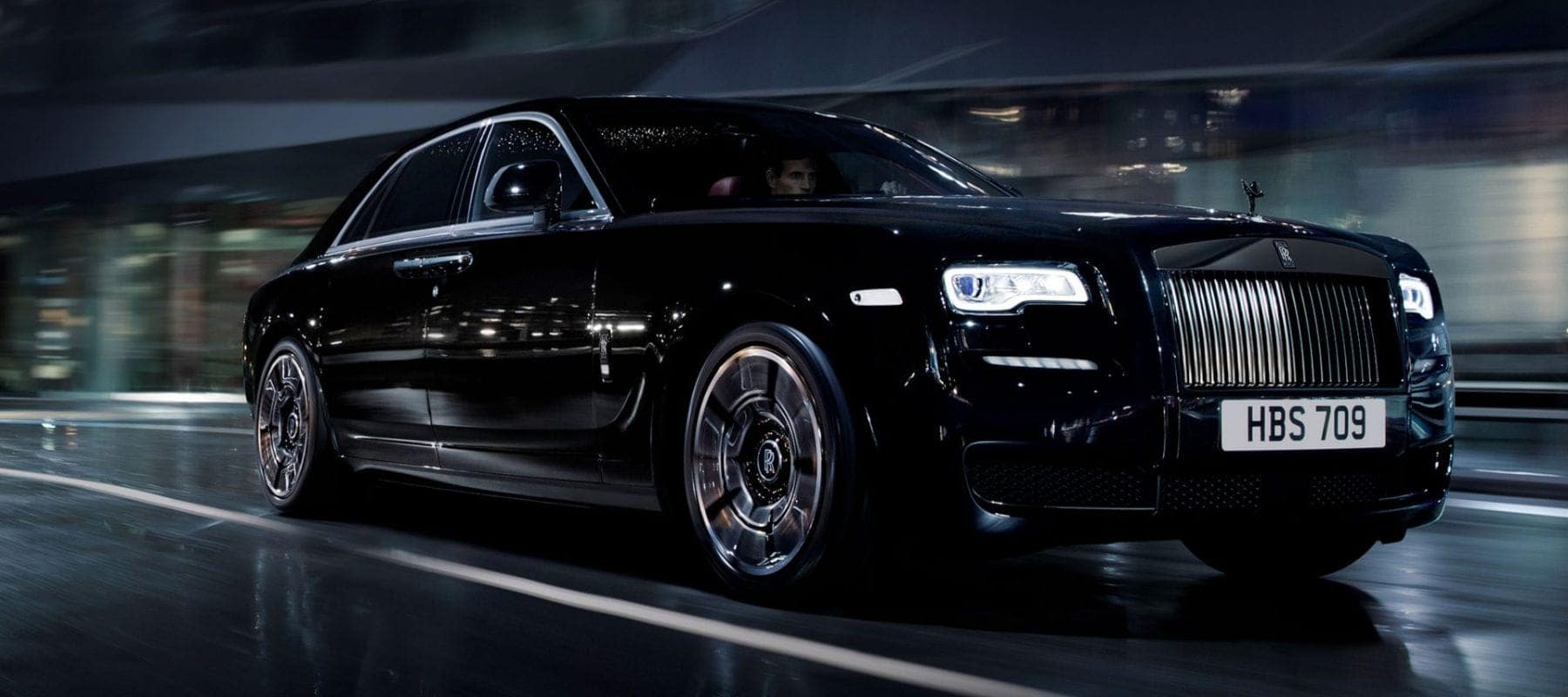 Angled view of a Rolls-Royce Ghost driving at night