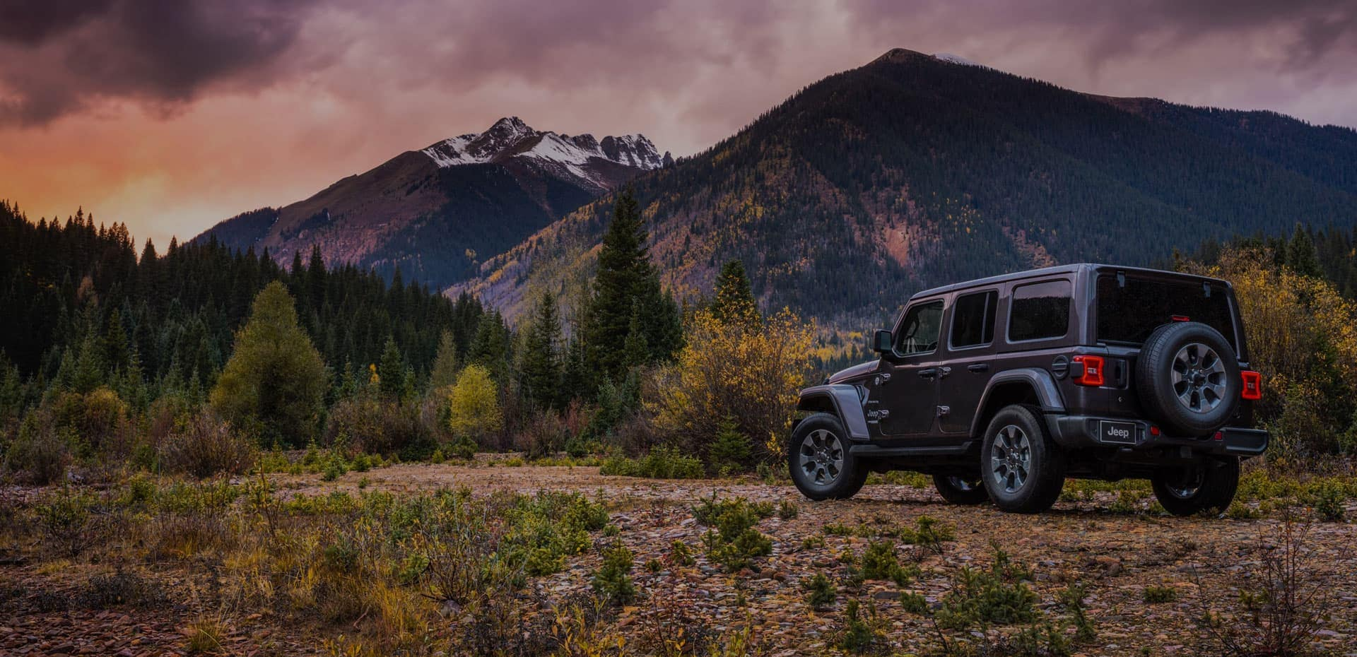 Jeep Wrangler sitting in front of the mountains