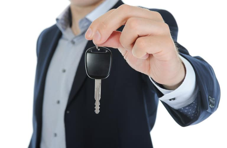 Person holding up car keys