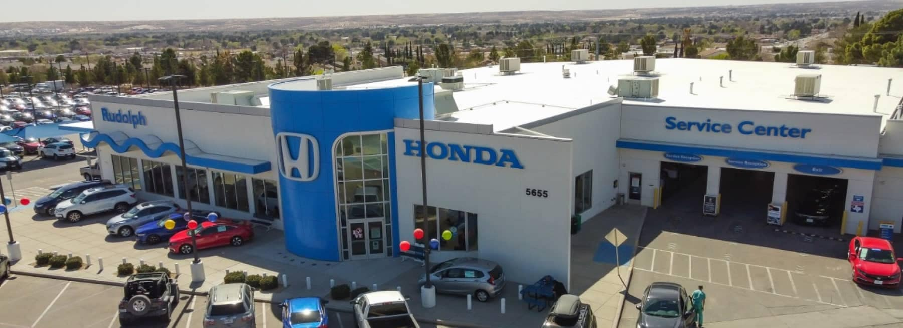 An exterior shot of a Honda dealership from aerial view