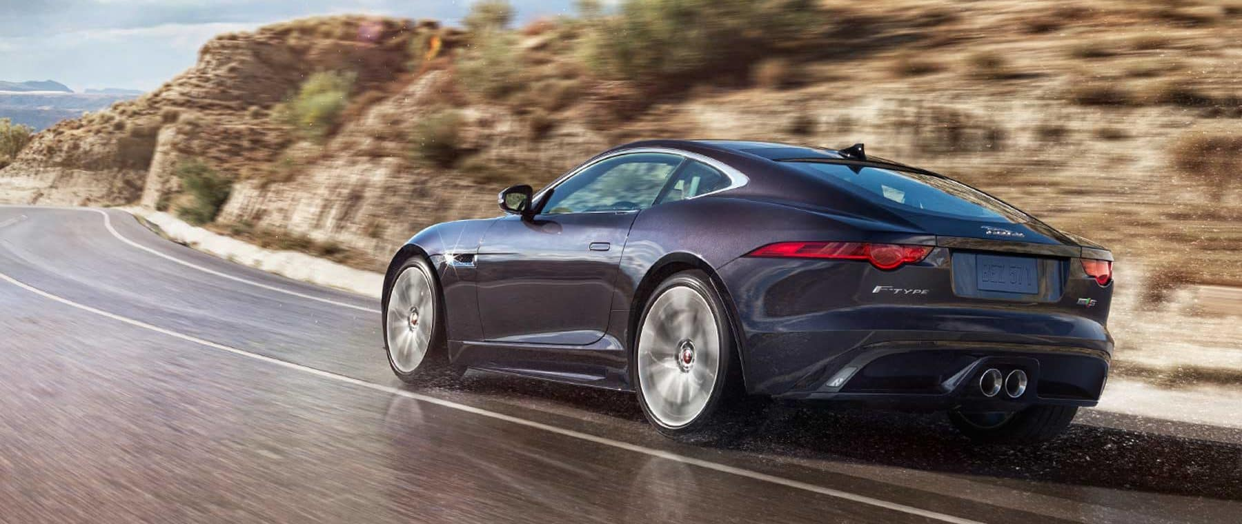Jaguar F-type driving on a desert road