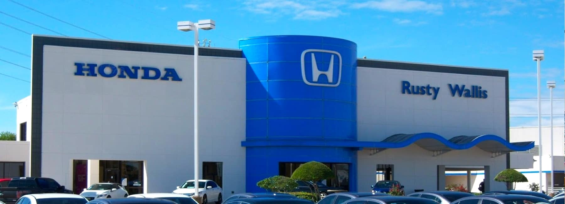 An exterior shot of a Honda dealership