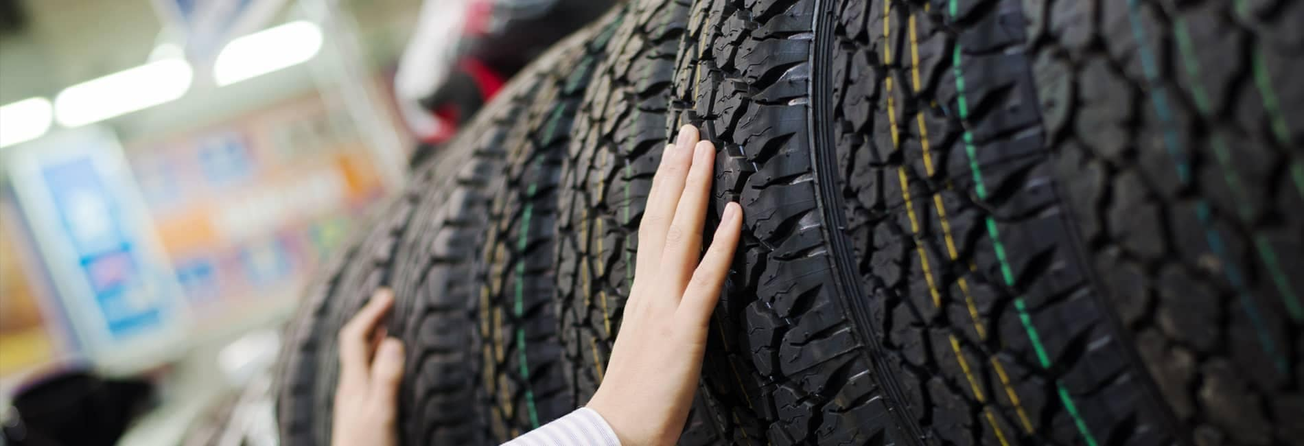 person touching a tire