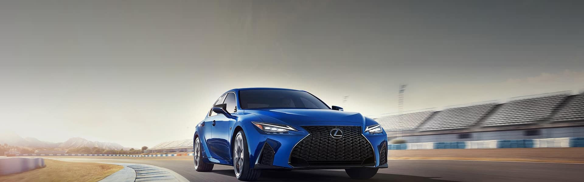 Blue Lexus Driving on racetrack