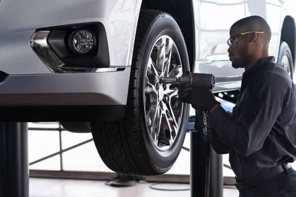 A mechanic changing a tire
