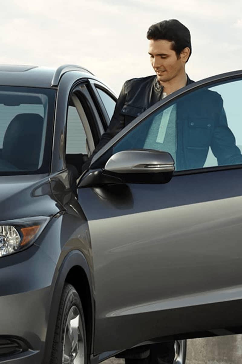 Man opening Honda car door