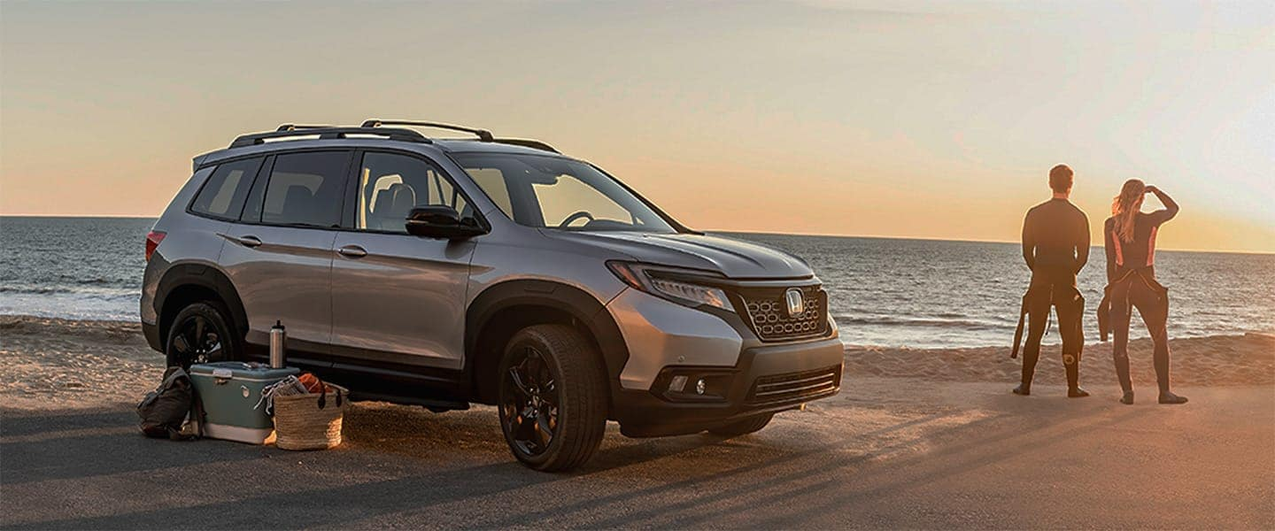 Honda SUV on Beach with Couple