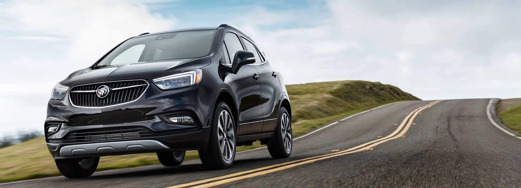 Black 2020 Buick Encore on a road_mobile