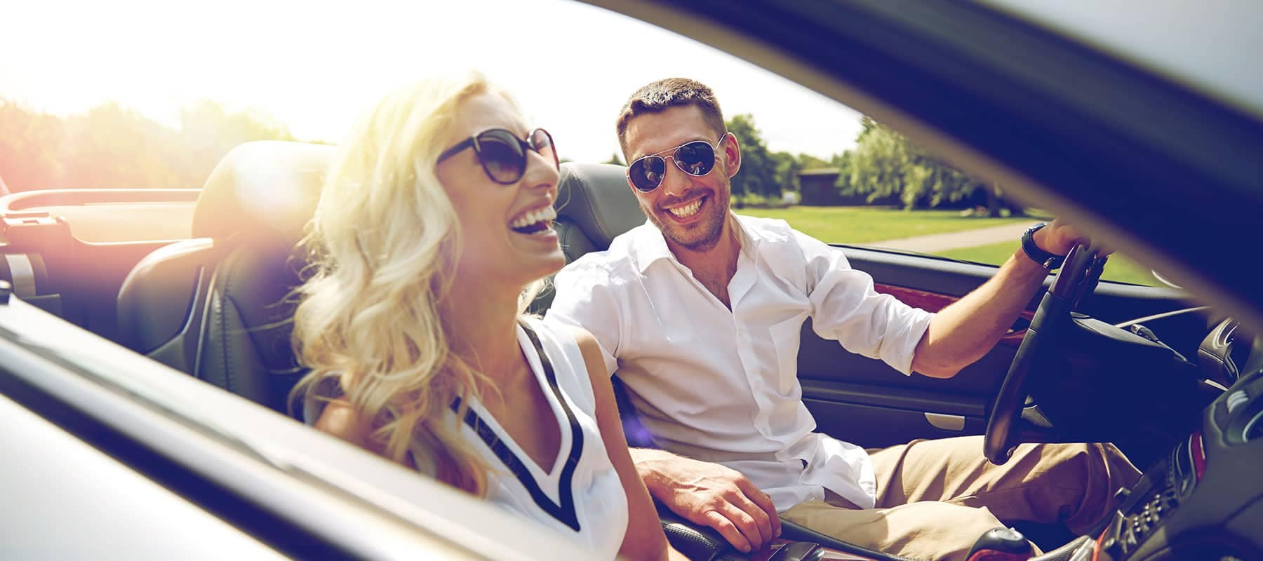 smiling couple in a convertible