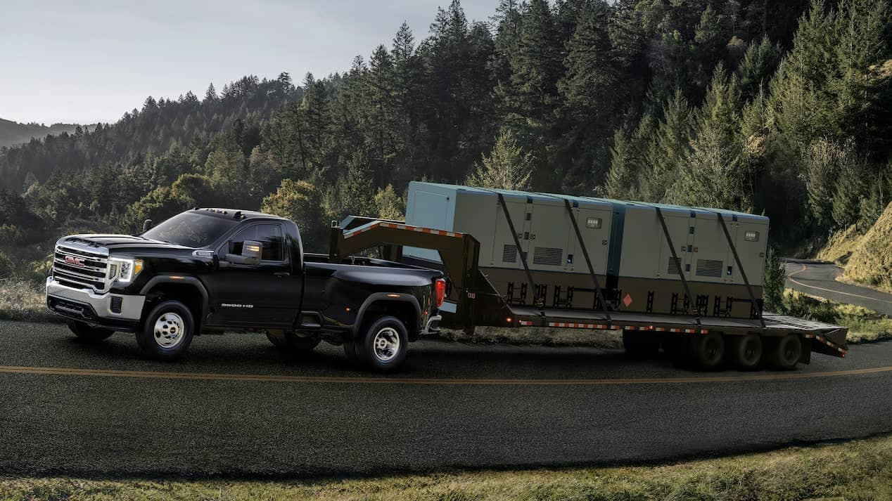 2020 GMC Sierra HD towing a trailer up a hill