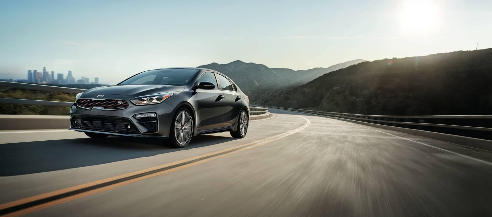 2020 Kia Forte driving on winding highway