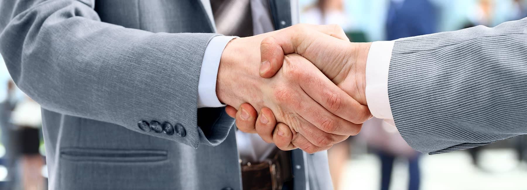 customer and dealer shaking hands