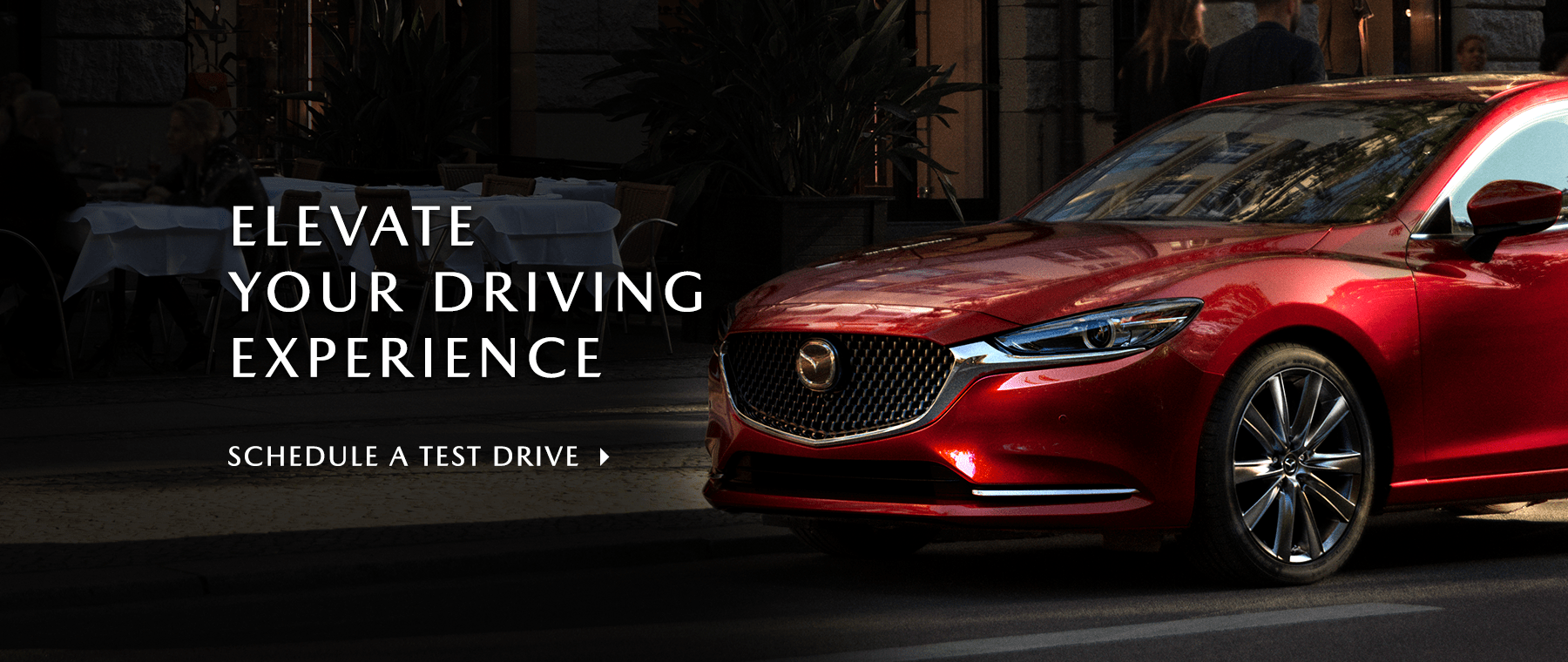 Elevate your driving experience red Mazda parked