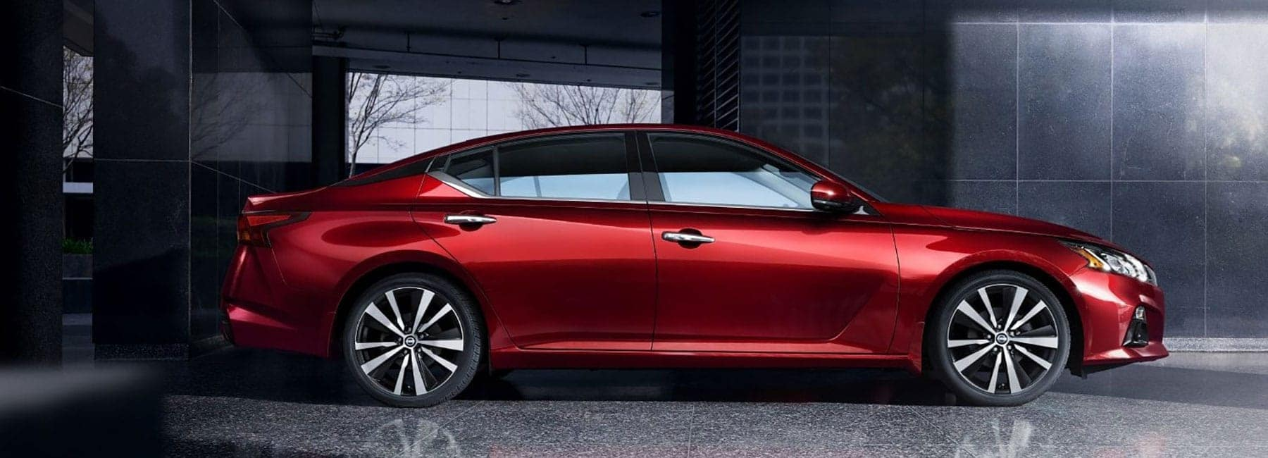 Side-view of a Red Nissan Altima