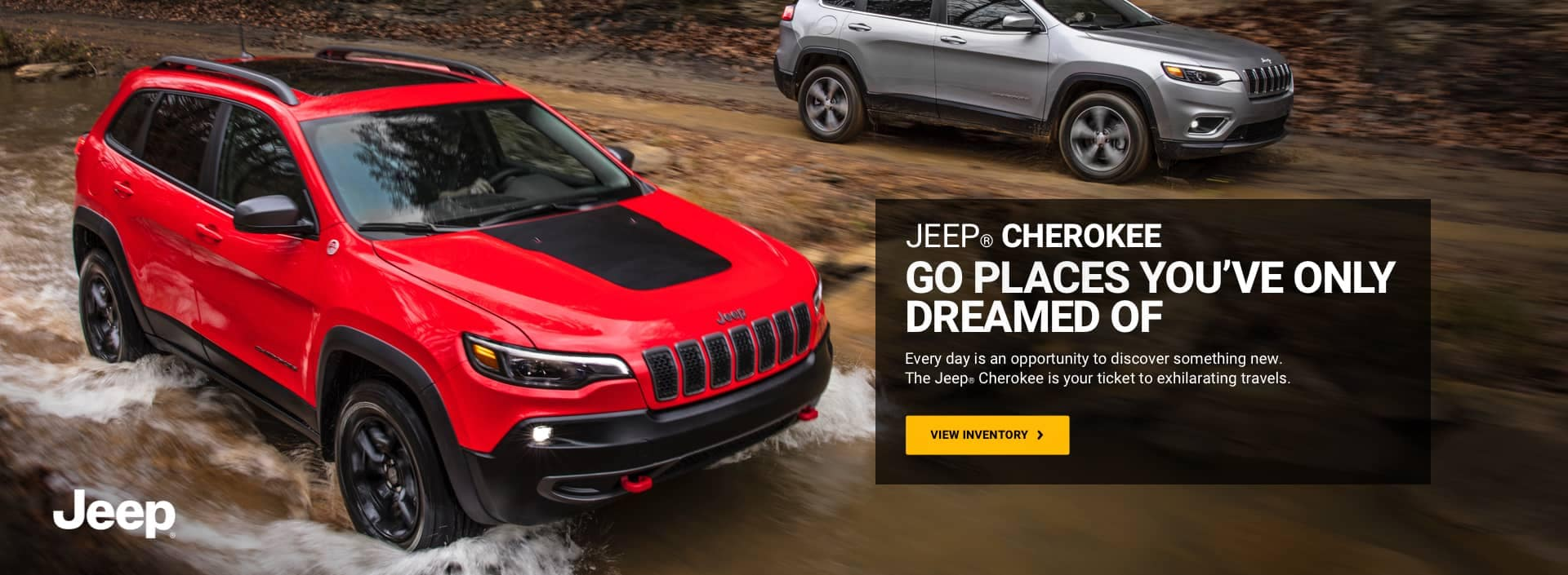 a Red and a gray Jeep Cherokee off roading