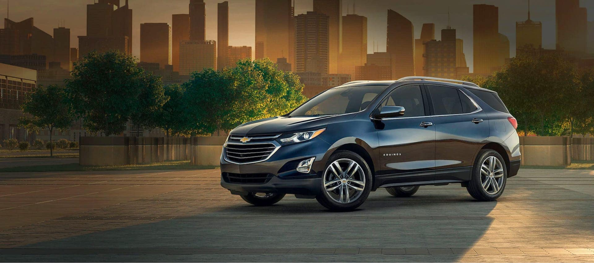Chevy Equinox parked with a city landscape in the background