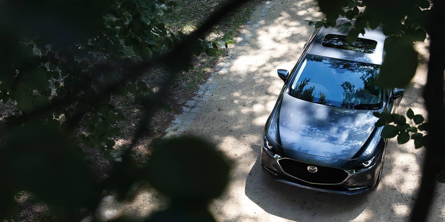 Mazda3 parked outside of building sky view of it