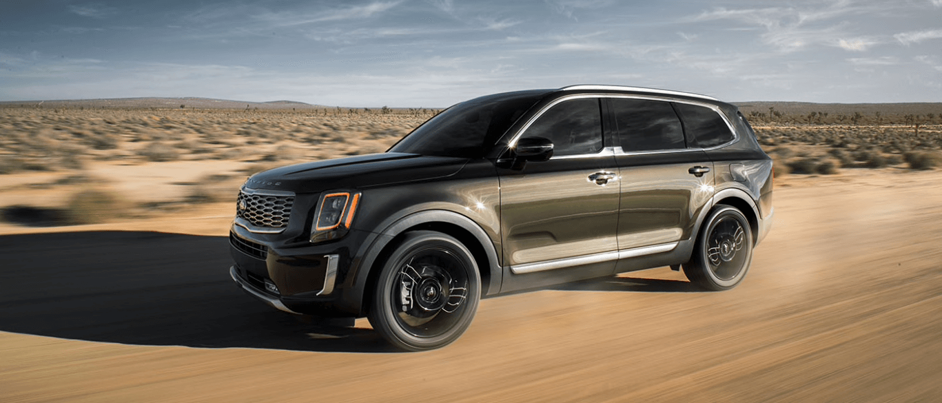 2020 Kia Telluride driving down a sandy road