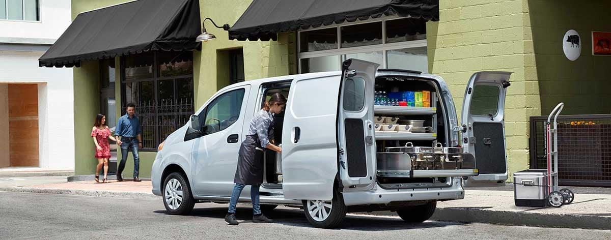 A food vendor unloading a NV Cargo Van.