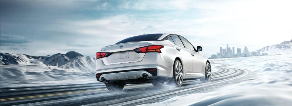 2019 Nissan Altima demonstrating AWD on a snowy street