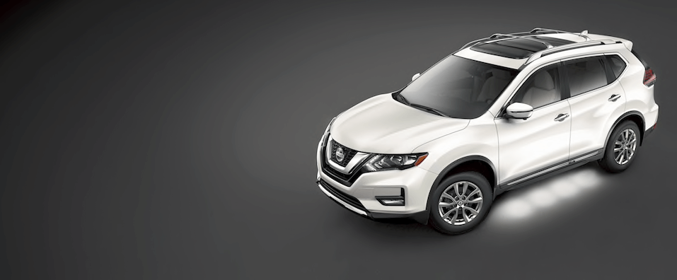 A white Nissan Rogue on a black background