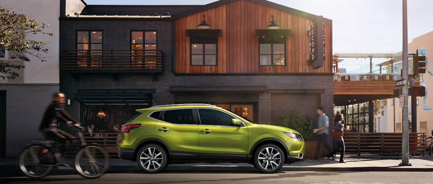 2019 Nissan Rogue Sport in green parked on a street