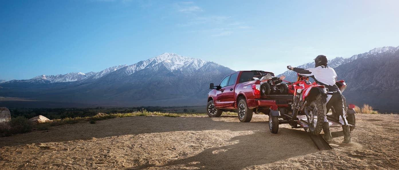 2019 Nissan Frontier towing an ATV