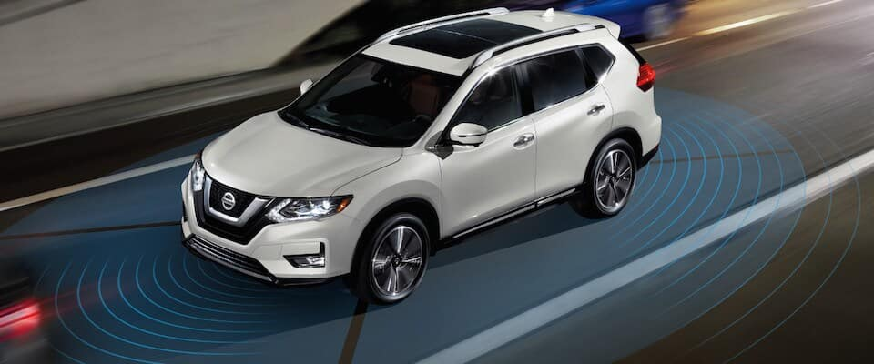 A white Nissan Rogue using a safety sensing system