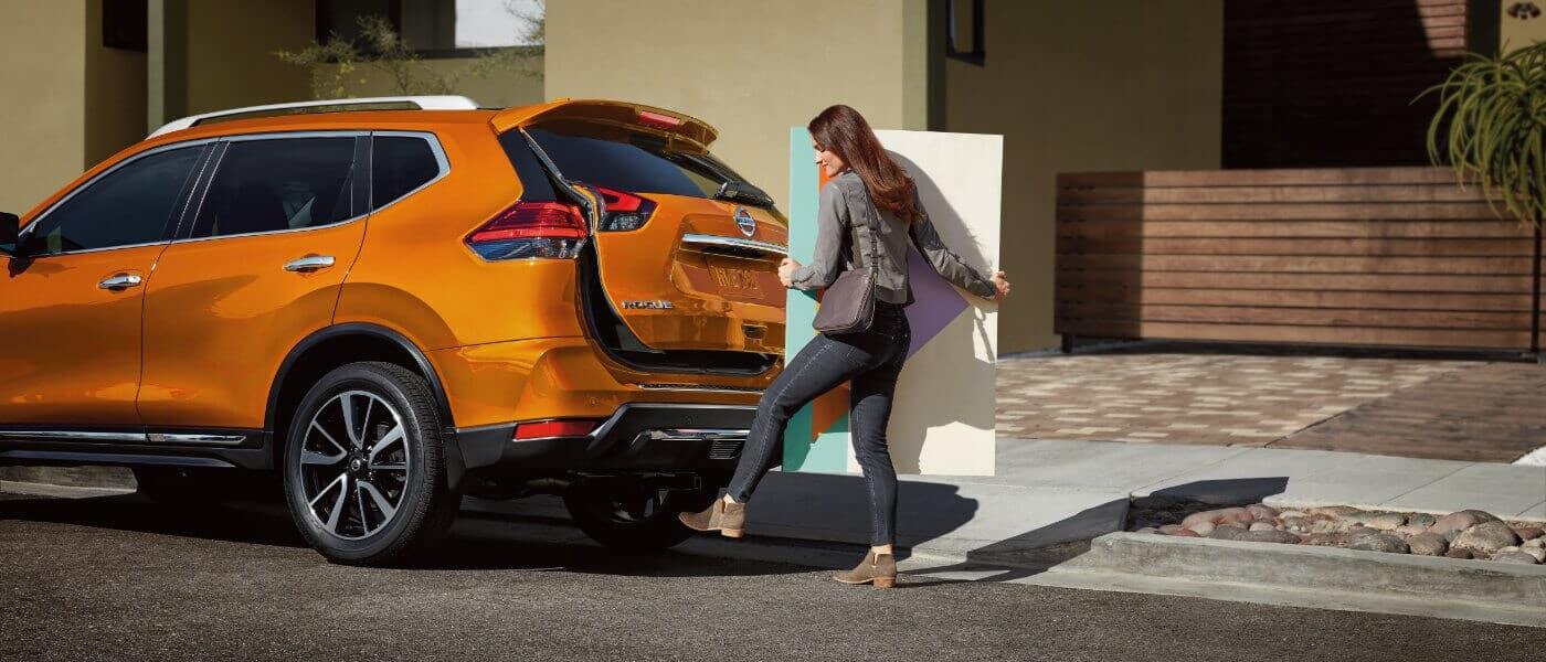 Orange 2019 Nissan Rogue on street