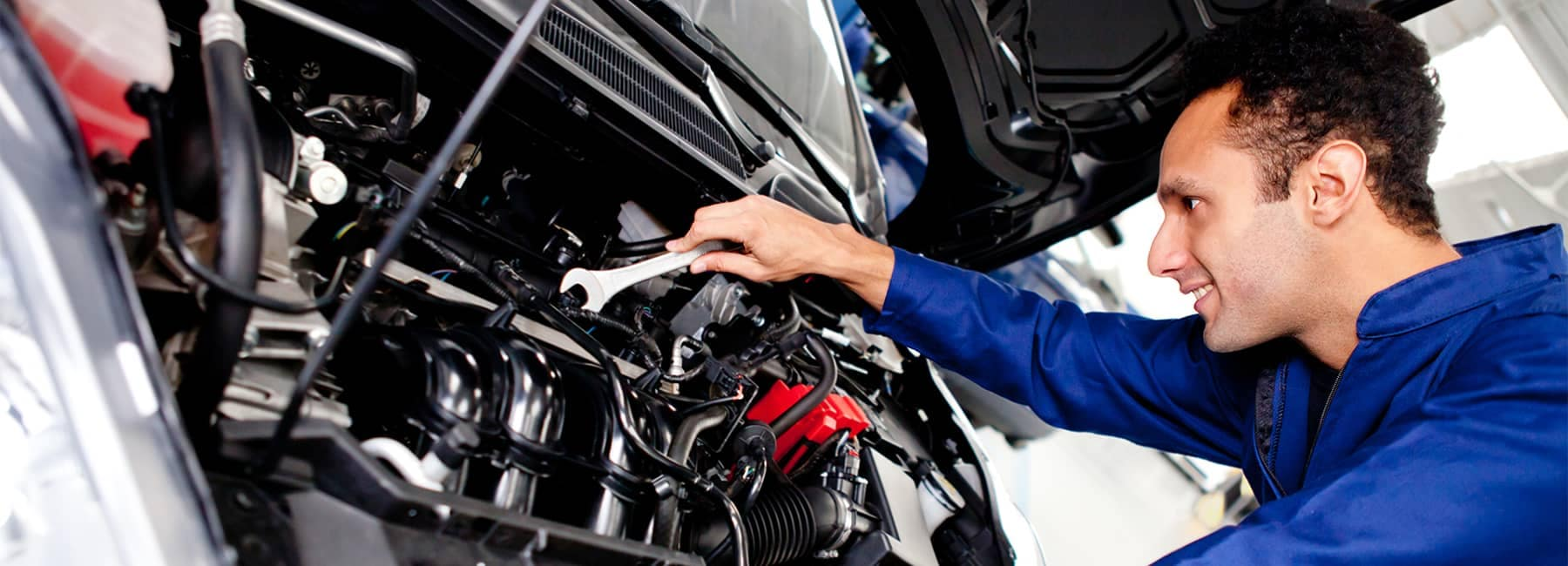 Mechanic Looking at Car Engine