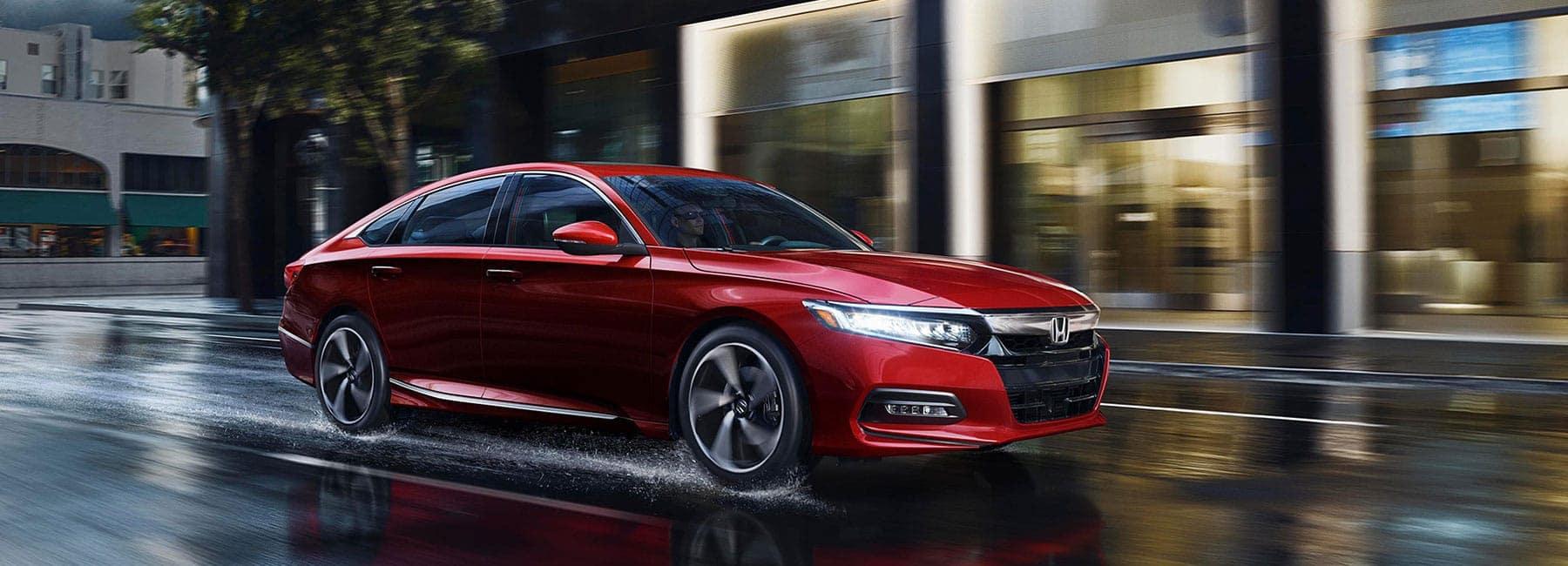 2019 Honda Accord speeds through wet city street