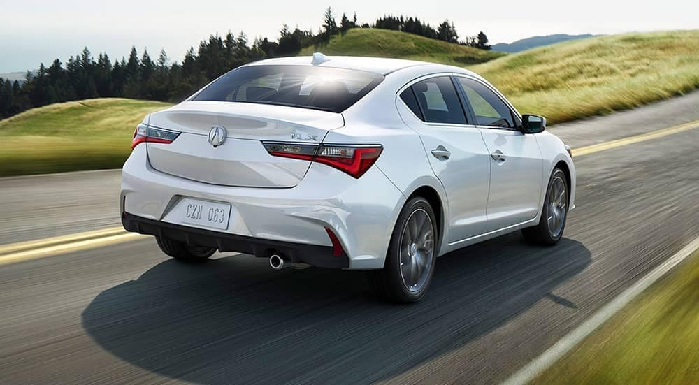 2020-Acura ILX speeding down a country road