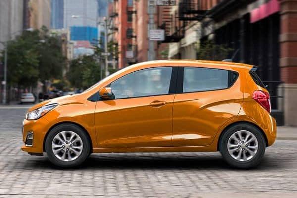 Orange 2020 Chevrolet Spark on a City Street_mobile