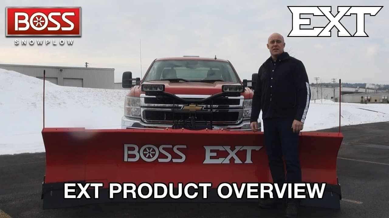 man standing in front of snow plow