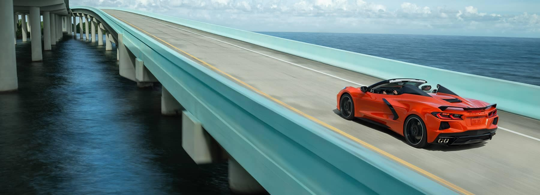 Red 2020 Chevrolet Corvette Stingray Convertible Driving on an Ocean Highway
