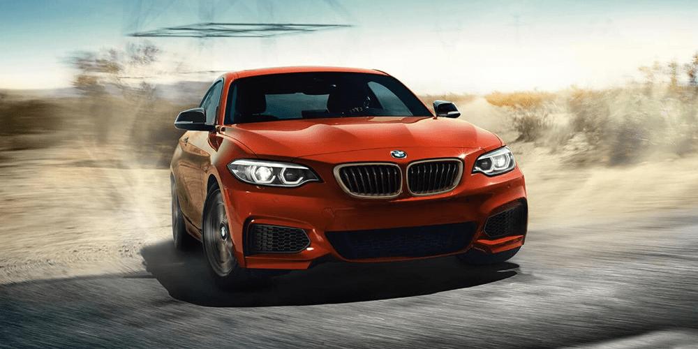 red BMW hitting its brakes