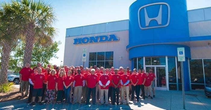 employees standing in front of Stevenson Hendrick Honda Wilmington dealership