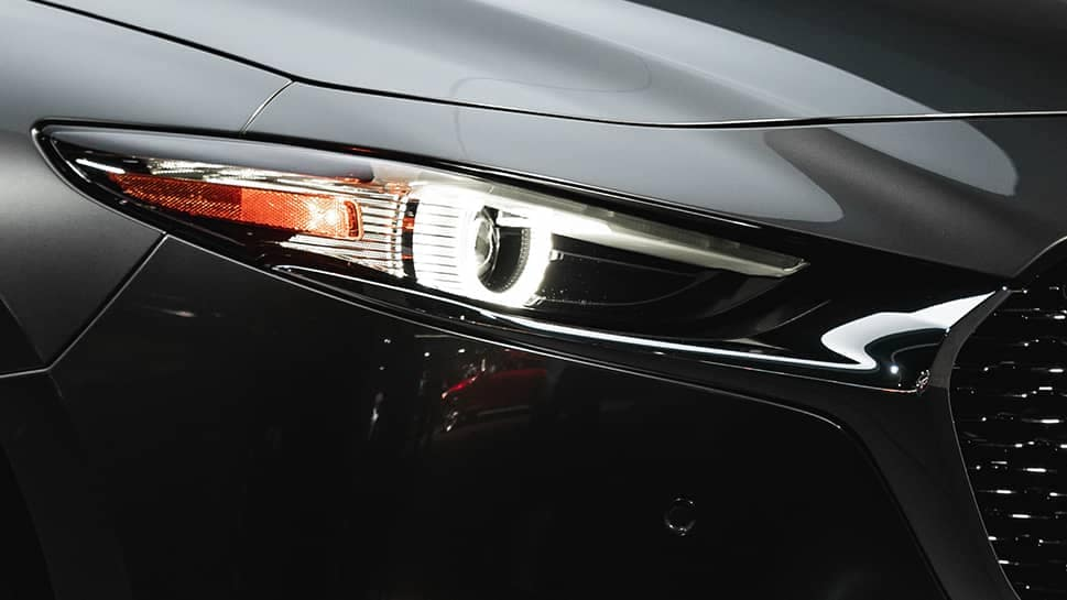 close up of Mazda3 front headlight