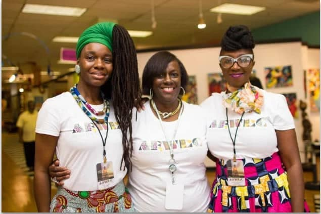 picture of 3 women wearing African outfits