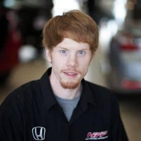picture of a young man with red hair and blue eyes