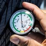 Mechanic checking tire pressure