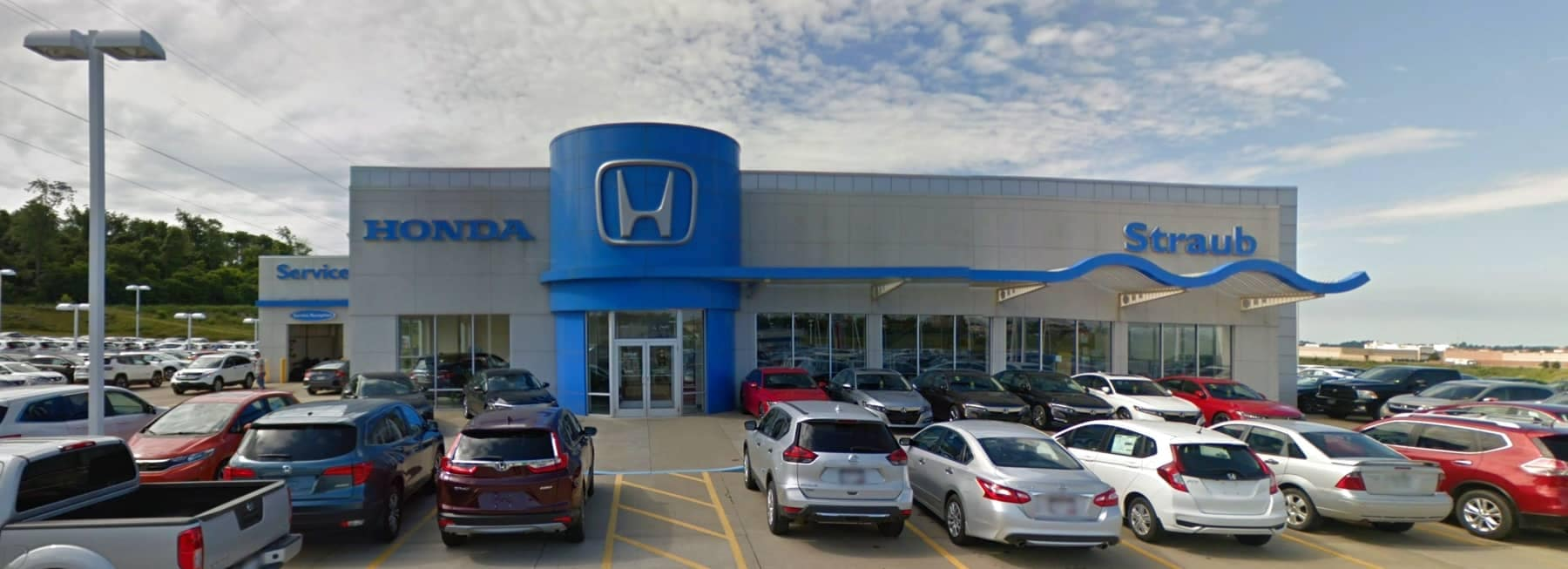 An exterior shot of Straub Honda dealership  during the day