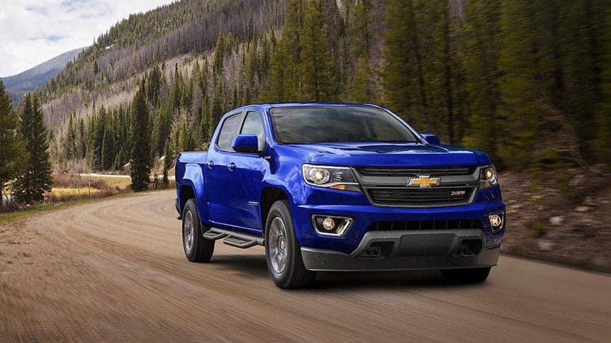 Front angle of a Chevy Colorado driving down a road