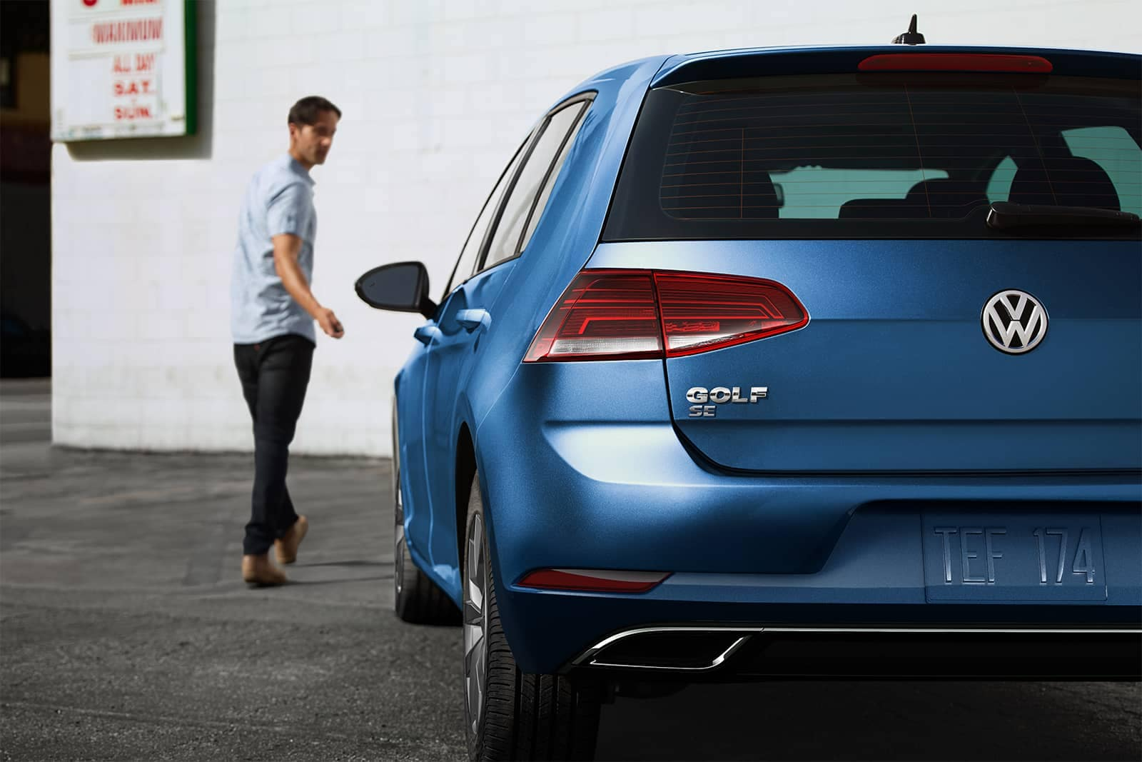 2019 Volkswagen Golf person walking away from car locking it