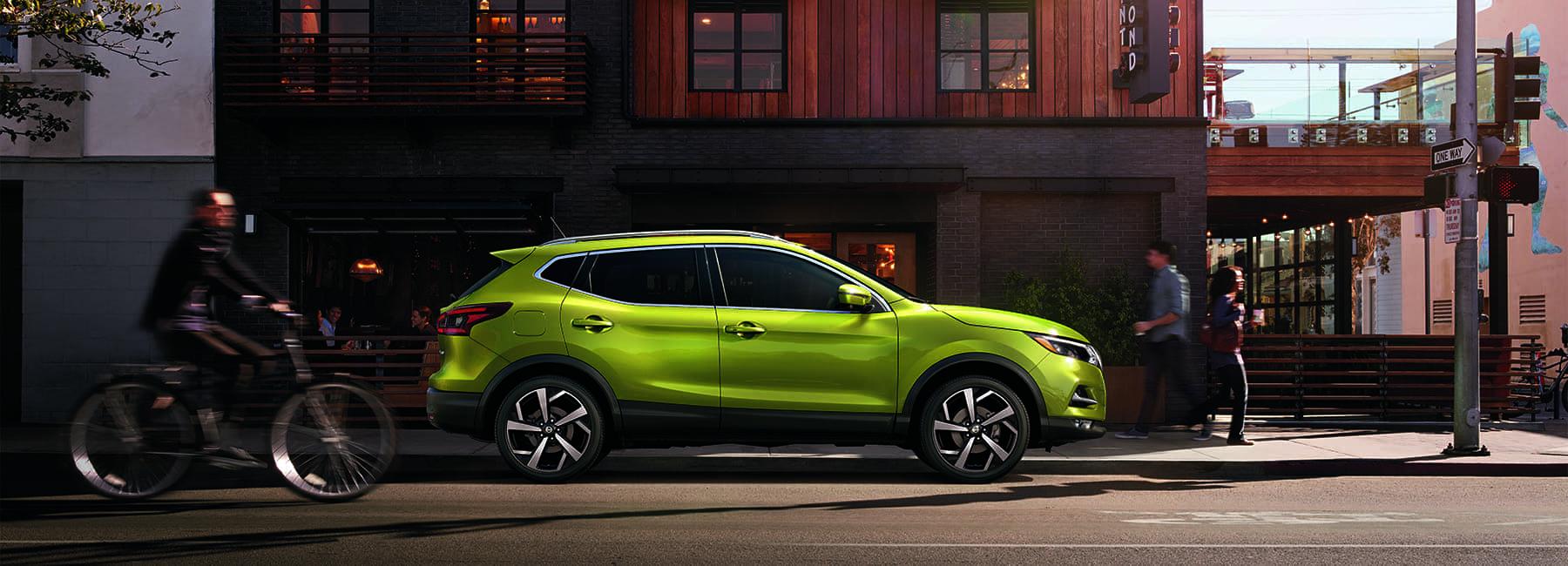 Green Nissan rogue sport parked