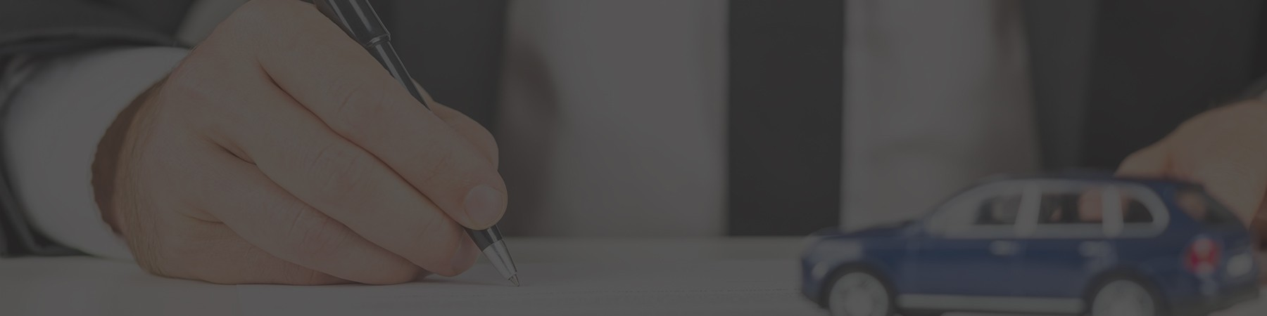 Person writing with a pen