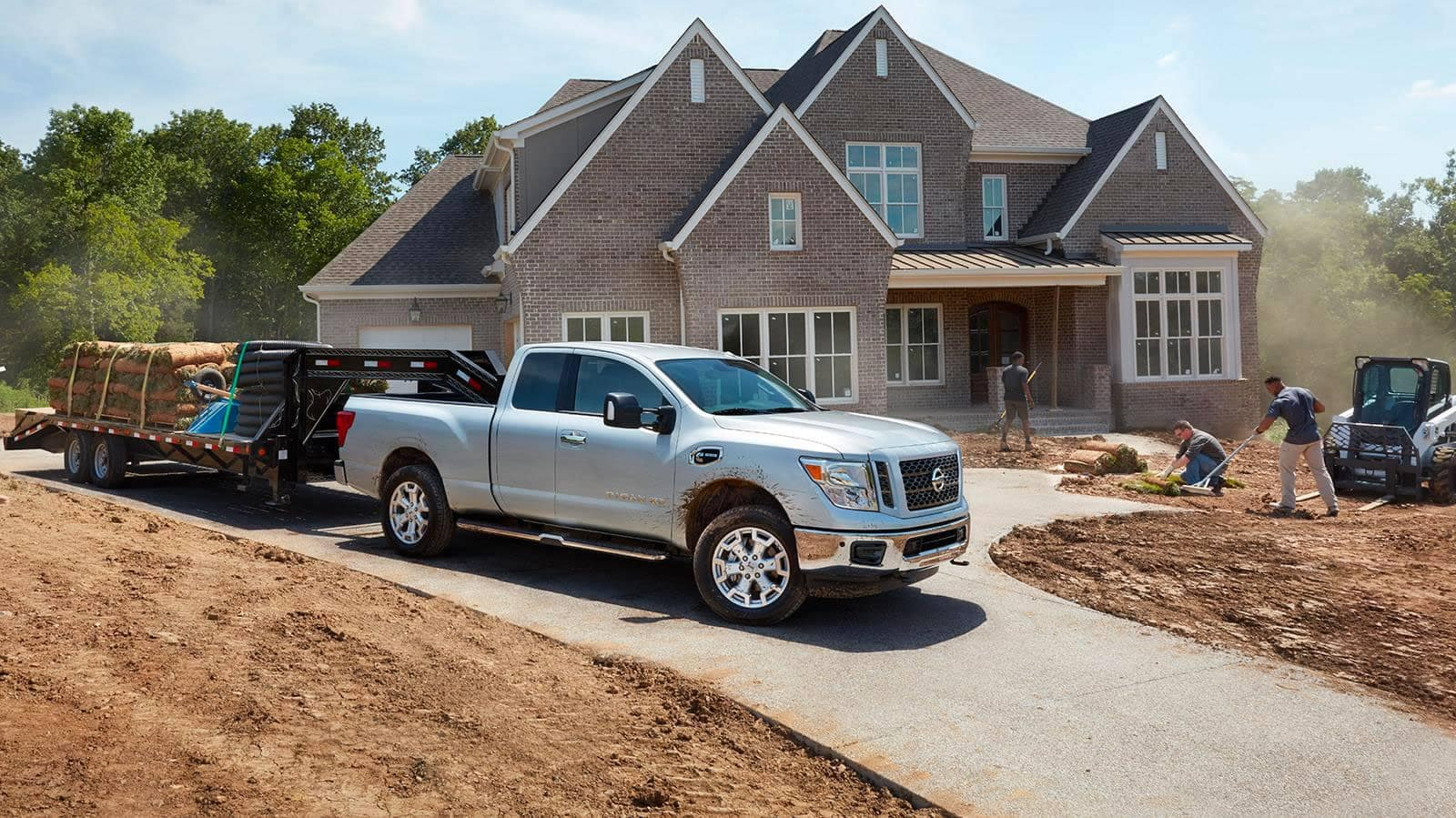 nissan truck infront of house under construction
