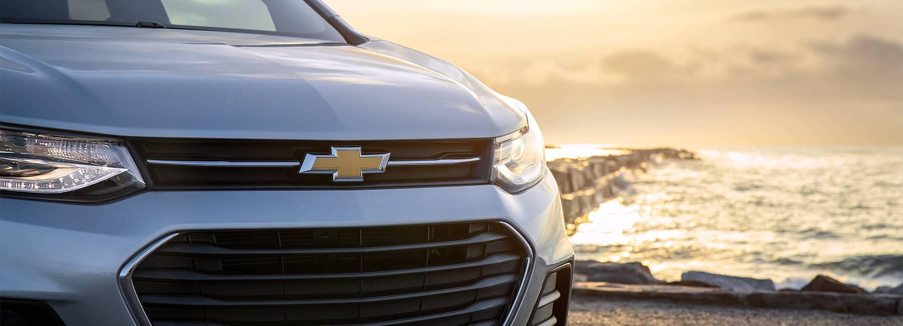 Closeup of the front of a white 2021 Chevrolet Trax
