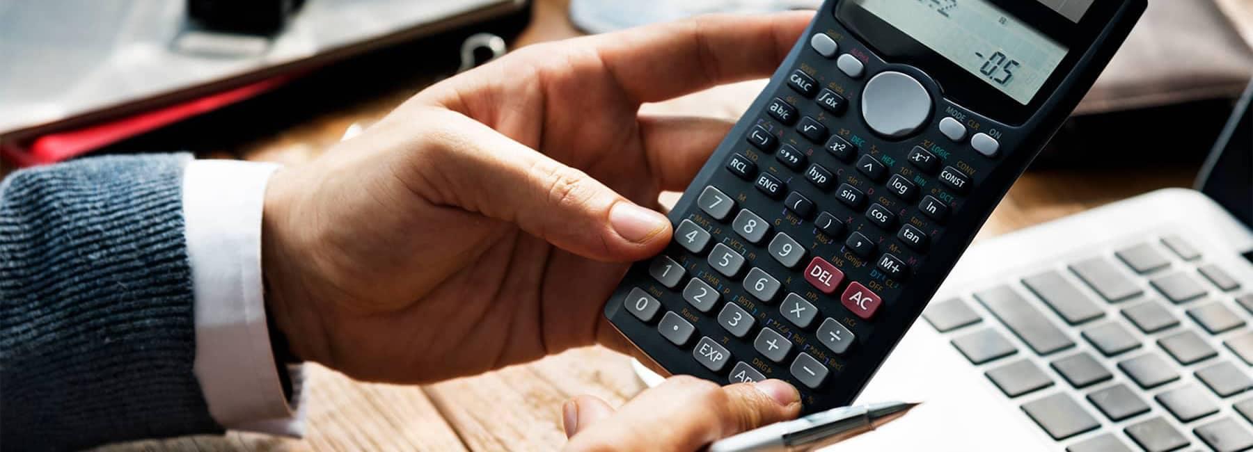 Hands Holding Calculator Dealership