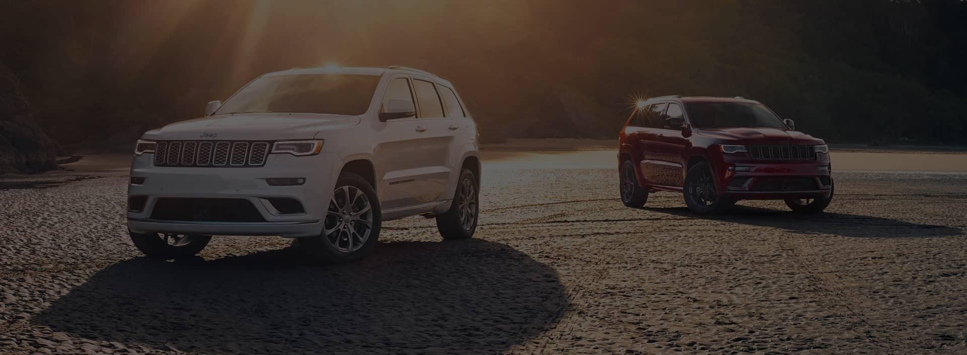 two jeep facing forward at an angle